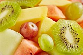 Fruit salad with melon, grapes and kiwi slices