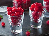 Fresh raspberries in shot glasses