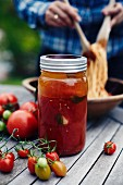Homemade pasta sauce in a screw-top jar