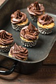 Mini cupcakes topped with chocolate ganache