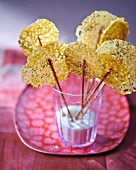 Cheese lollies with poppyseeds in a glass