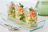 Three glasses of courgette salad with crayfish, mozzarella, oregano and pine nuts
