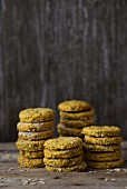 Healthy homemade oat biscuits with grains on a wooden surface