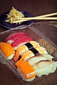 Tuna fish, prawn, salmon and mackerel nigiri in a plastic box