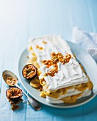 Meringue slices with a banana and passion fruit sauce