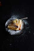 Crepes with yellow plum jam and icing sugar