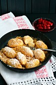 Quark dumplings with buttered crumbs and icing sugar (Austria)