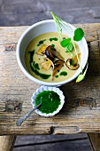 Potato soup with mushrooms and watercress