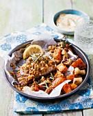 Pork chops with a lemon and rosemary crust and oven-roasted vegetables