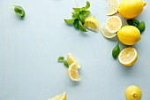 Fresh lemons and basil leaves