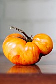 A Single Organic Yellow Heirloom Tomato