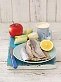 Ingredients for herring and apple salad: herrings, apple, onion, leek, sour cream
