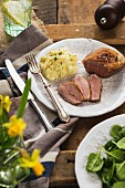 Rare fried duck breast with mashed potatoes