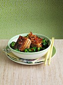 Pork belly with chillis and sesame seeds (Asia)