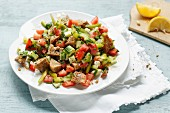 A summer bread salad with wholemeal baguette, tomatoes and cucumber