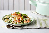 Quick fried prawns and pasta with green asparagus and peas