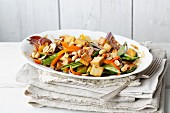 Stir-fried vegan vegetables with tofu and peanuts