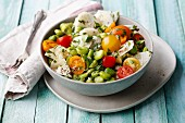Broad bean salad with colourful cherry tomatoes and radishes