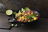 Vegan quinoa salad with tofu, mango and coriander
