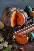 Pumpkins on a wooden table with an old pair of kitchen scales