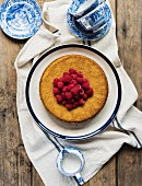 Olive oil cake with raspberries (seen from above)