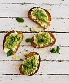 Slices of toasted bread with a pea spread