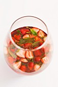 Sangria with strawberries and mint in a glass