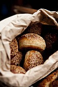 Sesame seed rolls in a bread bag