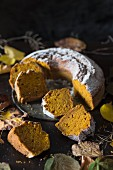 A sliced pumpkin wreath cake