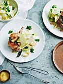 Roast pork cutlets with pear, witlof and hazelnut salad
