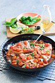 Swordfish steaks with cherry tomatoes and capers