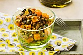 Vegan pumpkin and bean salad with pumpkin seeds