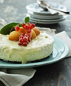 ice cream cake with peaches and redcurrants