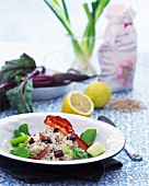Spelt risotto with beetroot, bacon, leek and lemons