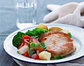 Pork steak with a vegetable salad
