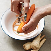 A carrot being grated