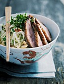 Kohlrabi salad with peanuts and fried duck breast
