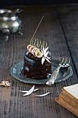 Chocolate tartlet with coconut and chocolate curls