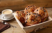 Cinnamon and raisin buns served with coffee
