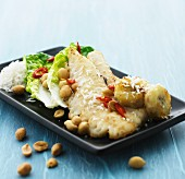 Marinated chicken breast with coconut, peanuts, bananas and chilli peppers (Asia)