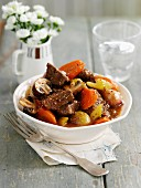 Braised beef with mushrooms, vegetables and ale