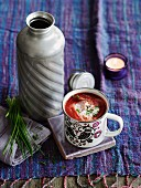 Borscht (beetroot soup, Eastern Europe) in an enamel mug