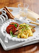 Scrambled egg with toast and grilled tomatoes