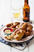 Lye bread pretzels with mini sausages and mustard