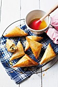 Filo pastry pasties filled with ricotta and honey