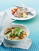 Coconut soup with beef, carrots and cauliflower served with baked salmon with tomatoes and lime