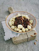 Gnocchi with an oxtail ragout and pine nuts