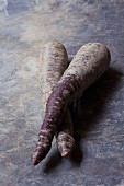 Two purple organic carrots