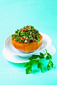 A tomato filled with tabbouleh