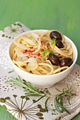 Spaghetti with fennel, olives, pink pepper and rosemary